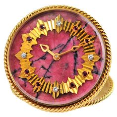 Minerals! This Rhodocrosite bedside clock from Van Clef & Arpels is 1960's glamour at its best. Wow!!!!