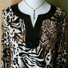 """JM Collection Leopard Print Tunic This top is 95% Polyester and 5% Spandex. It is machine washable. It has 3/4"""" sleeves. Bought, but never worn. It looks cute paired with black leggings and heels. JM Collection  Tops Tunics"""