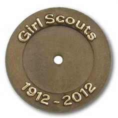 Worn in the anniversary year (2012) by Daisy through Ambassador Girl Scouts with their grade-level membership disc and star (purchased separately.) Package of 12. $5.00.