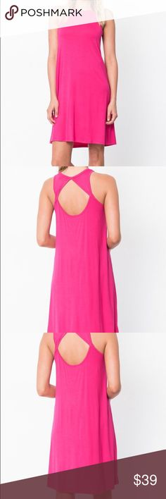 Shift Dress With Back Cutout This vibrant dress boasts a back cutout for skin-baring allure. * Size S: 37'' long from high point of shoulder to hem * 95% rayon / 5% spandex Dresses