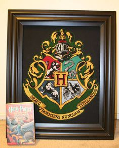 harry potter hogwarts crest from a cross stitch pattern - NEEDLEWORK  Actual pattern at http://s3.amazonaws.com/theleakycauldron/snuffles/craftfiles/needlework_hog4houses_hogcrest3_chart_littlemojo.pdf
