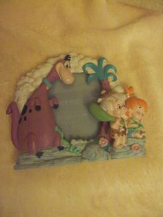 "Great collectible. This is a Flintstones, ""Pebbles, Bam-Bam and Dino"" Photo Frame. Measures 6.5"" x 5.5"". Preowned in excellent condition. This item comes from a smoke-free and pet free environment. 
