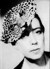 """Schiaparelli dubbed Chanel """"that dreary little bourgeoise"""" and Chanel referred to her as """"that Italian artist who makes clothes"""". In 1927, she opened her first salon, """"pour le Sport"""" which launched a line featuring bathing and ski suits.  Evening wear and costume jewelrly were added."""