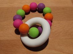 Silicone Teething Ring A beautiful colourful teether that your baby will love! The ring and beads are made from food grade Teething, Food Grade, Beads, Handmade Gifts, Rings, Etsy, Beautiful, Beading, Kid Craft Gifts