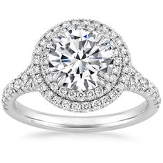 The stunning Gala Diamond Ring features a glittering double halo of diamond accents.