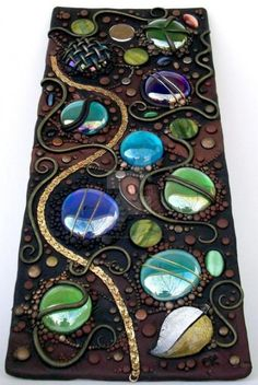 Polymer clay and iridescent glass gems on a clear acrylic tile. x I covered the tile with black Fimo clay, cut holes in the clay and place. Polymer clay on clear acrylic Polymer Clay Kunst, Fimo Clay, Polymer Clay Projects, Polymer Clay Creations, Polymer Clay Jewelry, Clay Beads, Clay Earrings, Mosaic Art, Mosaic Glass