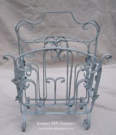 The cutest wrought iron magazine rack ever done in Louis Blue!