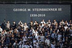 October 18, 2017:  Astros on brink of elimination after being shut out by Yankees in Game 5.   New York Yankees fans stand for the National Anthem under a memorial for the late owner of the Yankees, George Steinbrenner, before Game 5 of the ALCS against the Houston Astros at Yankee Stadium on Wednesday, Oct. 18, 2017, in New York. ( Karen Warren / Houston Chronicle )