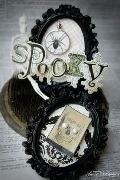Halloween decor: thick black frames with decorative items
