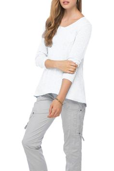 """This chic and flirty lightweight sweater has its embroidery panel in the back with a ribbed hem for a """"layered"""" look. There is a small pocket on the front. It is a light and easy choice for your relaxed days. It is made of 100% white cotton and the design is fitted. It should be hand washed in cold water or dry cleaned. XS/S fits 2-4 S/M fits 4-6 and M/L fits 8-10.  Embroidered Back Crew by subtle luxury. Clothing - Tops - Casual Boulder Colorado"""