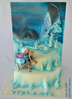 Disney Frozen multi-tiered Cake featuring a winter setting with Anna and Kristoff riding Sven and Queen Elsa and her ice castle in the distance. Olaf is beside Sven.