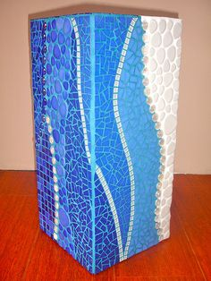 Tall flower pot in blue and white mosaic