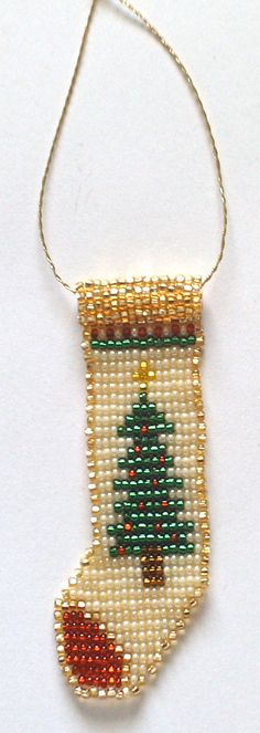 This is hand beaded that measures 3 long and 1 wide. It is made with 638 seed beads. This will add that variety to your tree or it will make a great