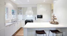 Pristine white contemporary kitchen with a homely atmosphere. Dendy Project | Atkinson Pontifex. #modernkitchen