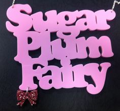 Sugar Plum Fairy necklace in pale pink with a Pink Glitter bow.
