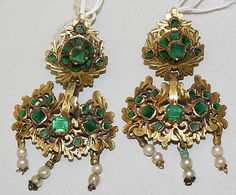 *EARRINGS* These beautiful earrings are of Spanish origin from the 19th century. Materials are unknown, but they seem to be made of emeralds, pearls, and gold. http://www.metmuseum.org/Collections/search-the-collections/90234?rpp=20&pg=1&ao=on&ft=earrings&when=A.D.+1800-1900&pos=14