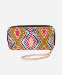Could this wallet be more fun? The funky geometric designs and practical wrist strap make this the perfect piece for a night out, or for a grab-and-go accessory for any occasion.