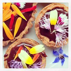 chocolate ganache tarts with edible flowers from greensofdevon.com