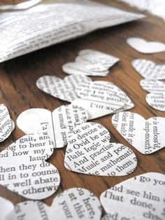 Recycled paper wedding confetti - I think we need to get a heart punch! Think you can get some old newspapers saved for me? :)