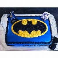 used the Batman cake pan for the top cake and a full sheet pan for ...