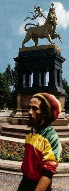 "Addis Ababa, Ethiopia. Bob Marley standing before ""The Lion of Judah"" during his pilgrimage trip to Ethiopia.."
