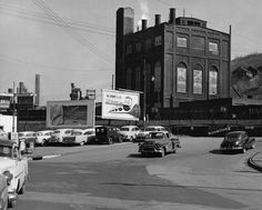 At the bottom of Prospect Viaduct, Iron St. building in background. 1950's I think.