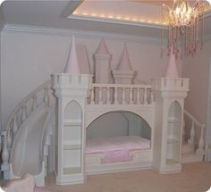 Probably the cutest bed ever!!! Noah loves castles & slides! He would go crazy over this bed in a more boyish theme!