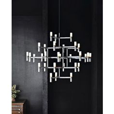 <p><span>Product+description:+</span></p> <p><span>The+Crown+Major+Suspension+Chandelier+was+designed+by+Markus+Jehs+and+Jurgen+Laub+in+2009+for+Nemo+Italianaluce.+The+Crown+Major+chandelier+is+perfect+for+someone+wanting+amodern+twist+on+a+classic+candelabra+chandelier.+Fits+perfect+in+a+large+contemporary+space+with+high+ceilings.+Available+in+two+finishes,+polished+aluminum+or+white,+both+have+a+red+cord+which+adds+an+additional+flare.</span></p> <table> <tbody> <tr> <td><span>Ma...