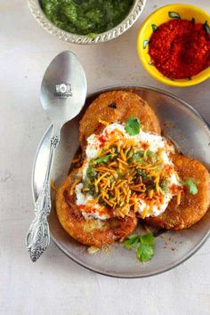 Aloo Tikki Chaat Recipe is hard to give a miss if you are on a tour to devour Indian Street Food. Find recipe of how to make perfect Aloo Tikki Chaat Indian Appetizers, Indian Snacks, Indian Food Recipes, Vegetarian Recipes, Cooking Recipes, Chinese Recipes, Veg Recipes, Curry Recipes, Cooking Tips