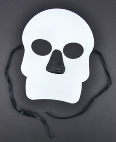 This basic Day of the Dead Mask in White can be easily transformed into the perfect holiday mask with some glitter and craft paint!