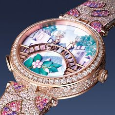 In spring, the dial of the Lady Arpels watch is adorned with pink flowers and its bracelet with pink, mauve and purple sapphires. Slide to see the meticulous craftsmanship behind the Lady Arpels Pont des Amoureux Printemps watch. Van Cleef And Arpels Jewelry, Van Cleef Arpels, High Jewelry, Jewelry Box, Jewelry Hooks, Jewelry Cabinet, Geek Jewelry, Gold Jewellery, Jewelry Bracelets