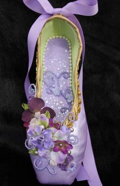 A personal favorite from my Etsy shop https://www.etsy.com/listing/512211456/decorated-pointe-shoe-lilac-fairy