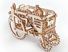 The Tractor from UGEARS is a thundering greetings from the past century! That's why you won't see any electronics here. Instead of this we offer you a rubber engine and a small gear lever into three modes. In the mode «park» the tractor starts. In the «drive» it rumbles and leisurely goes fingering its pistons. And in the mode «sport» it will race at full speed! Fun to build and a gift for any occasion. Impress your friends and family as part of your home decor. A GREAT PRESENT TO GIVE FOR…