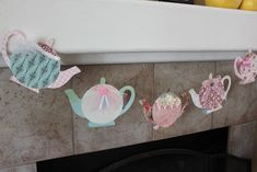 Tea pot garland from a free printable template and use of scrapbook paper and craft items to decorate
