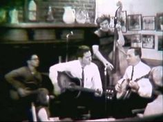 Earl Scruggs playing banjo at Dr Nat Winston's house for a local TV feature in 1964.