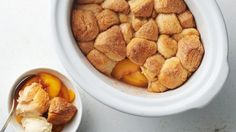 This easy slow-cooker peach cobbler has just 5 ingredients and is finished in the oven for a delicious cinnamon and sugar biscuit-topped dessert.
