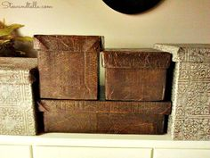 Pretty Storage made from Cardboard boxes...made to look like with Leather Boxes