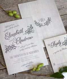 Rustic chic wedding invitation suite with woodgrain background and cursive lettering.