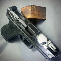 From @infinite_irons -  #infiniteirons #punisher #glock19 in black and white…