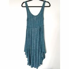 Free People Retro Beach Knit Teal Dress Great condition. Worn once. Knit with soft slip built in on the skirt. Midi dress, longer in the front and back and shorter on the sides. drawstring waist. Free People Dresses Midi