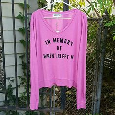 """{Wildfox} """"After Children"""" v-neck jumper. """"IN MEMORY OF WHEN I SLEPT IN"""" is boldly printed across the front.  Just got this today...very lovely, but I don't like the way it hangs on me.   Peony pink, a flattering spring-bright color. Relaxed, easy fit with a wider silhouette.   Poly/rayon/spandex like the beach jumpers, but smoother surface...no pilling, lighter weight.  TAGGED LARGE, WOULD WORK BEST FOR MEDIUM AND LARGE, SMALL IF YOU LIKE AN OVERSIZED FIT.  BUST MEASUREMENT: 24.5"""" ACROSS…"""