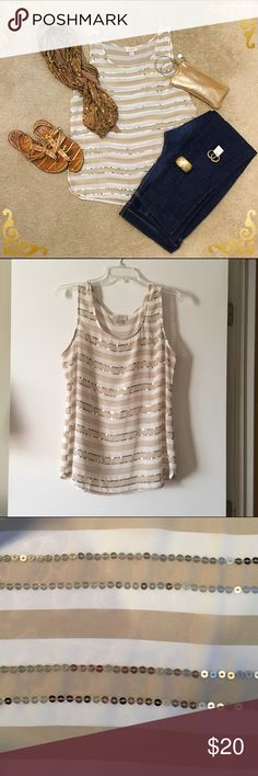 Lovely Sequined Stripped Blouse Lovely tan and white stripped Blouse with gold sequin embellishments on the front. Still in excellent condition/no missing sequins. This is see through so you will have to wear a cami underneath but it really is a super cute and classic piece that won't go out of style. True to size but the fabric does not stretch so if you're in between a L and XL then this may not work for you. Earrings shown in 1st picture are also for sale: seem my closet for listing and I…