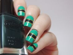 More pics and details here:http://marinelovespolish.blogspot.fr/2014/07/green-and-gold-striping-tape-mani.html