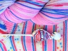 """This is part of my brand new Candy Jar collection! This is for a single  hank of """"Blow Pop"""" self striping sock yarn. This yarn is also available as  a bundle that includes the other candy yarns and a drawstring bag.  460 yards/100gram hank  75% superwash wool, 25% nylon  Gauge: 7-8 stitches/inch on #1-3 needles  machine wash cold, tumble dry low"""