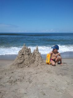 A great sandcastle build with a handtrux