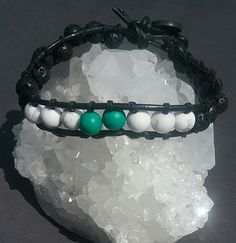 Aromatherapy wrap bracelet hand stitched with black lava beads, howlite, and…