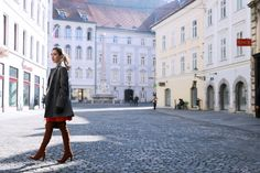 Ljubljana Slovenia architecture streets Fashion blogger Veronika Lipar of Brunette From Wall Street sharing how to wear the red dress