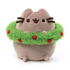"This 4.5"" Pusheen holiday plush is ready to celebrate the season with a festive red and green wreath. - Pusheen plush toy in classic pose brings adorable web comic to life - Features cute holiday-them"