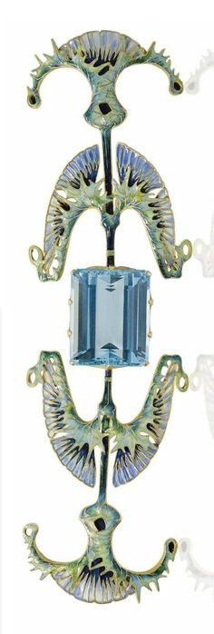 RENÉ LALIQUE - AN ART NOUVEAU AQUAMARINE AND ENAMEL 'THISTLE' DEVANT-DE-CORSAGE, CIRCA 1899. Centring a rectangular-cut aquamarine within an openwork stylised foliate surround of thistle design, applied throughout with multicoloured enamel, with French assay marks for gold, signed Lalique, with maker's mark for René Lalique #historicjewelry #GoldJewelleryArtNouveau