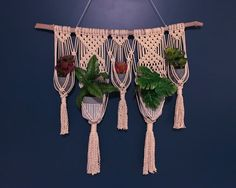 This macrame wall plant hanger was handcrafted on a piece of driftwood found along the shores of Maine. It is made of 100% cotton rope and natural wood. The hanging measures approximately 34 wide including the driftwood (26.5 without) and 48 long including the string to hang (31.5